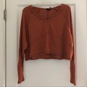 Orange long sleeve sweater